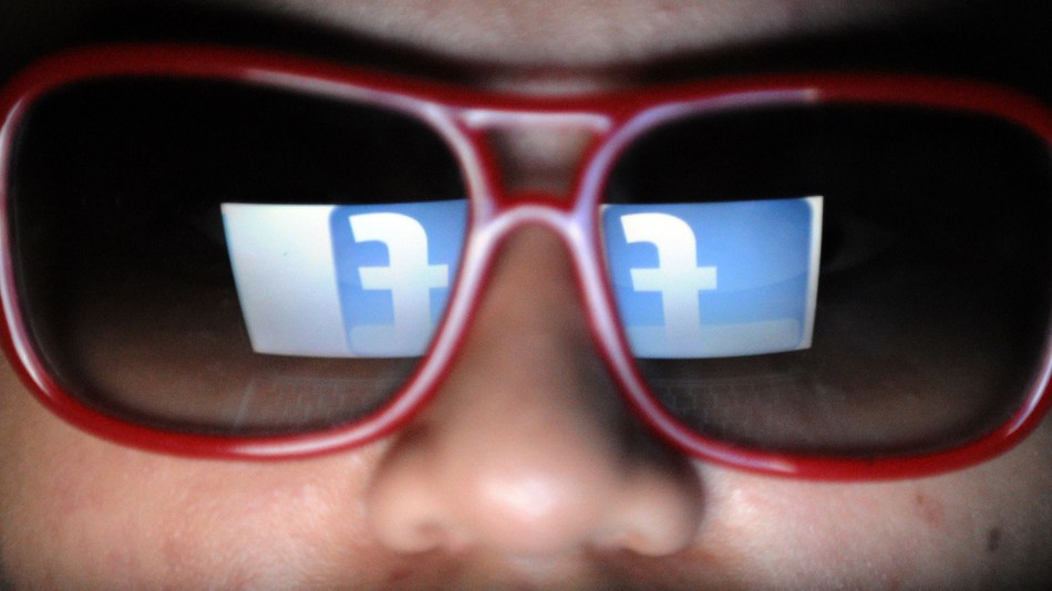 facebook logo reflected in glasses