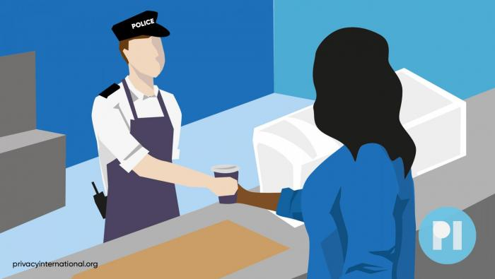 person being handed coffee by a police officer