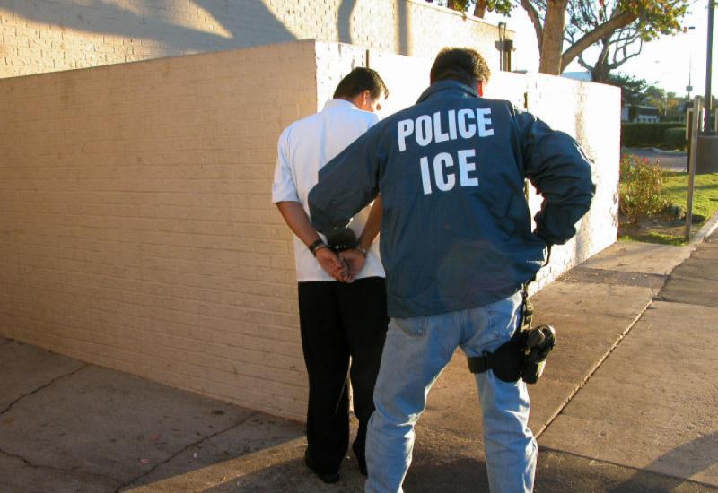 https://commons.wikimedia.org/wiki/File:US_Immigration_and_Customs_Enforcement_arrest.jpg