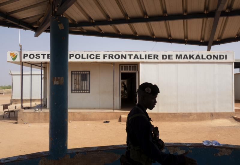 An agent during his guard duty out of the police border post of Makalondi, at the border between Niger and Burkina Faso. Ph. by Francesco Bellina