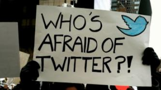 Protest banner about Twitter