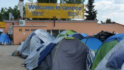 "Tents and sign ""Welcome to Greece"""