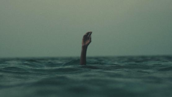 Hand in sea drowning