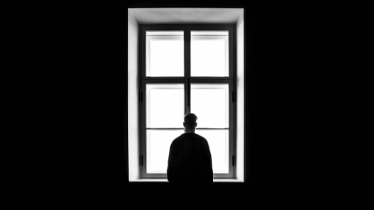 Man staring at the window