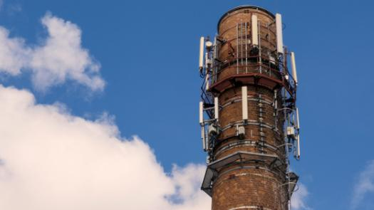 Factory chimney with mobile phone antennas
