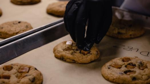 Hand reaching for a cookie