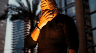Man in Tel Aviv covering his face covid 19 in Israel